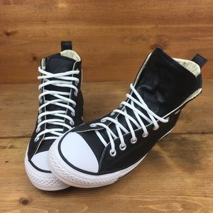 Converse Chuck Taylor's black leather high tops